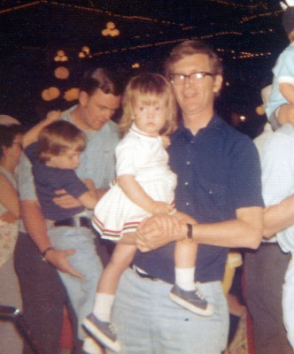 1975 at Disney World, truly realizing that, even after a long-day, my sister Maureen wouldn't always fit on his arm so easily.