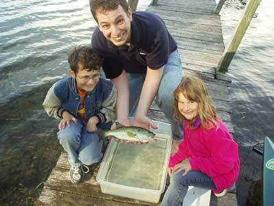 "The kids with Uncle Paul and ""Ol' Chomp,"" the large-mouth bass."
