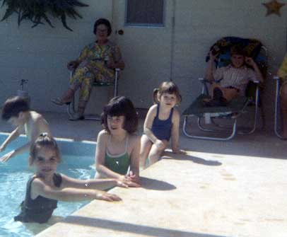 Laura with JimBob kids in pool 1972