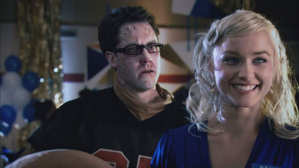 "Michael McKiddy, the unmasked seal, and Natalie Victoria in ""Deadheads"""