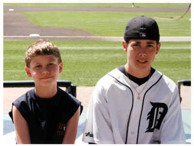 My brother and I at Comerica Park in what I think is 2000. He's wearing a jersey that doesn't have a player on the back. Not because we couldn't get one that had a player's name, but, who would he get? Bobby Higginson? What was the point? When I was growing up, the Old English D itself was embarrassing, much less the names of the players. How times have changed.