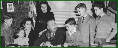 Governor Harry Kelly with his family during a radio address.