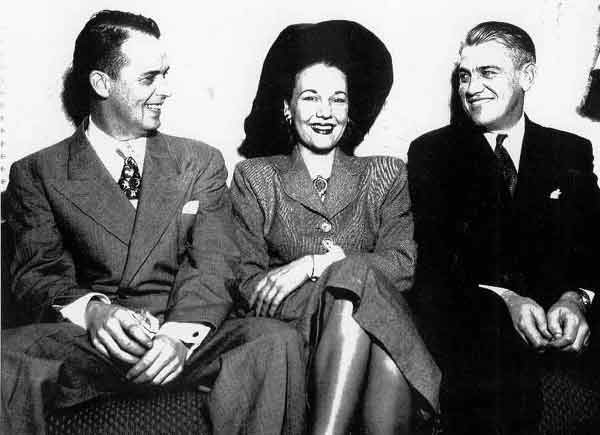 Jerry Kelly (left) with his brother Walter at their Detroit record store--with guest Dorothy Lamour.