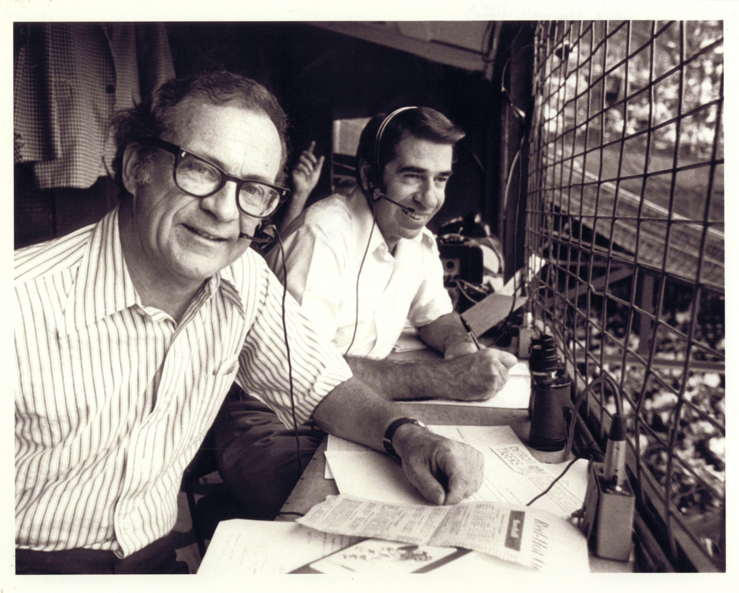 Ernie Harwell and Paul Carey broadcasting a Tigers game.
