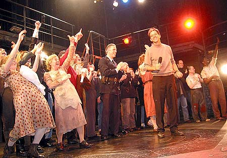 "01-19-04  Director John Rando with the mike at the Curtain call at the closing night of ""Urinetown"" at the Henry Miller Theatre on West 44th St. Sunday nigt 01-18-04"